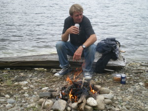 Campfire cooking at a lake